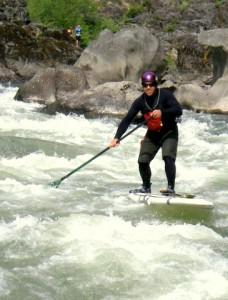 2010-Summer-Southern-Oregon-Rogue-River-Jayson-Bowerman-on-a-stand-up-paddle-board