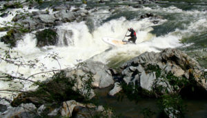 2010-Summer-Southern-Oregon-Rogue-River-Jayson-Bowerman-going-over-the-falls-stand-up-paddling