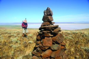 2011-Autumn-Eastern-Oregon-Hike-Outdoors-The-Steens-Wildhorse-Canyon-Brent-Fenty-takes-note-of-cairn