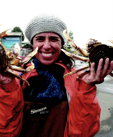 2011-Summer-Oregon-Coast-Travel-lady-holding-two-Dungeness-crabs