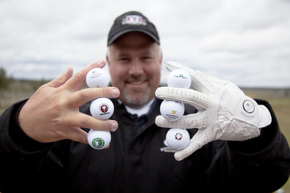 2011-Summer-Oregon-Golf-Travel-Chris-Meier-golf-balls-in-hands