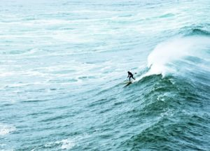 2010-summer-oregon-coast-outdoors-pacific-city-stand-up-paddling-gerry-lopez-riding-waves