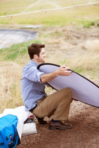 2012-summer-1859-central-oregon-bend-tumalo-cover-shoot-behind-the-scenes-truck-guy-holds-reflector