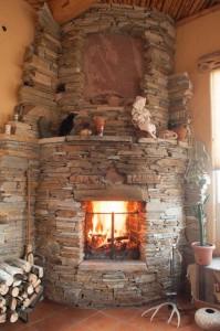 2012-November-December-1859-central-Oregon-Design-Fireplaces-bend-pueblo-stone-fireplace