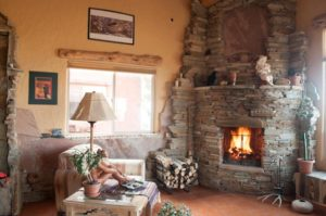 2012-November-December-1859-central-Oregon-Design-Fireplaces-bend-pueblo-stone-fireplace-window