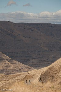 2013-July-August-Oregon-Travel-Explore-Eastern-Oregon-Tim-Labarge-View-of-Riders-on-Road
