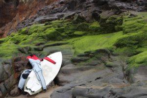 2013-may-june-1859-magazine-oregon-coast-surfing-surfboard-on-rocks