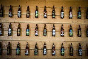 2013-november-december-1859-magazine-portland-oregon-hops-hopworks-urban-brewery-beer-bottles-on-wall