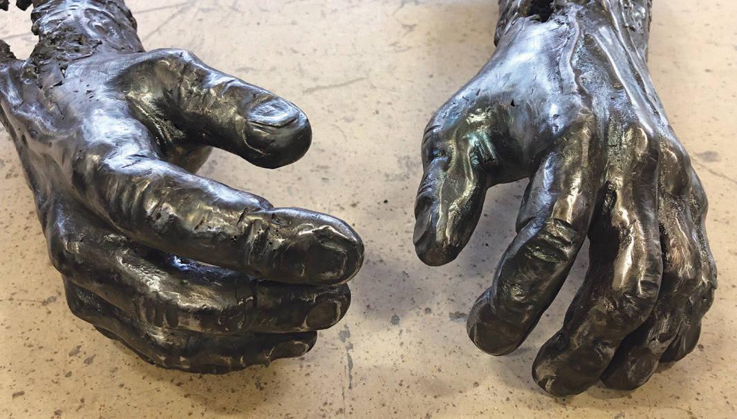 Two hands welding sculpture
