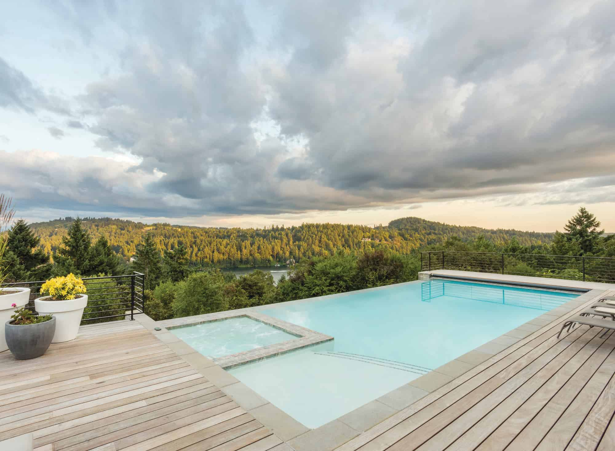This infinity pool is positioned to reflect bright clouds passing over this Lake Oswego home on their way to Mount Hood.