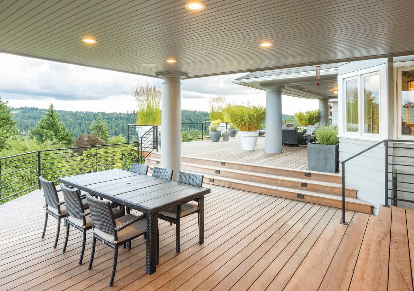 The skyline is unimpeded by the open railing on the ipe wood deck.