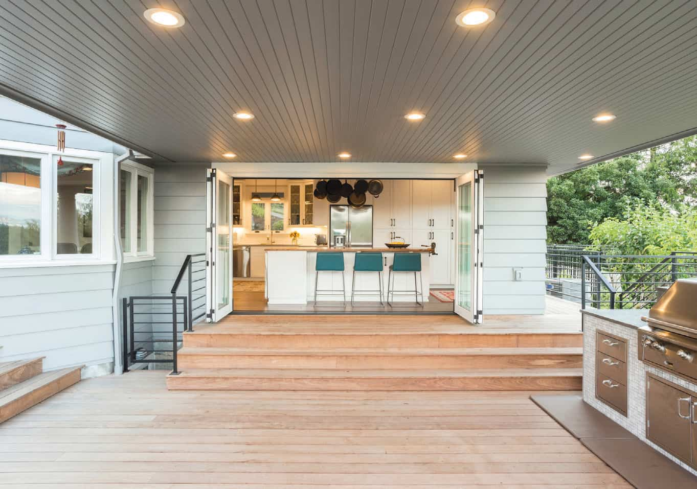 Two sets of wide La Cantina doors let the kitchen open out onto a spacious portico.