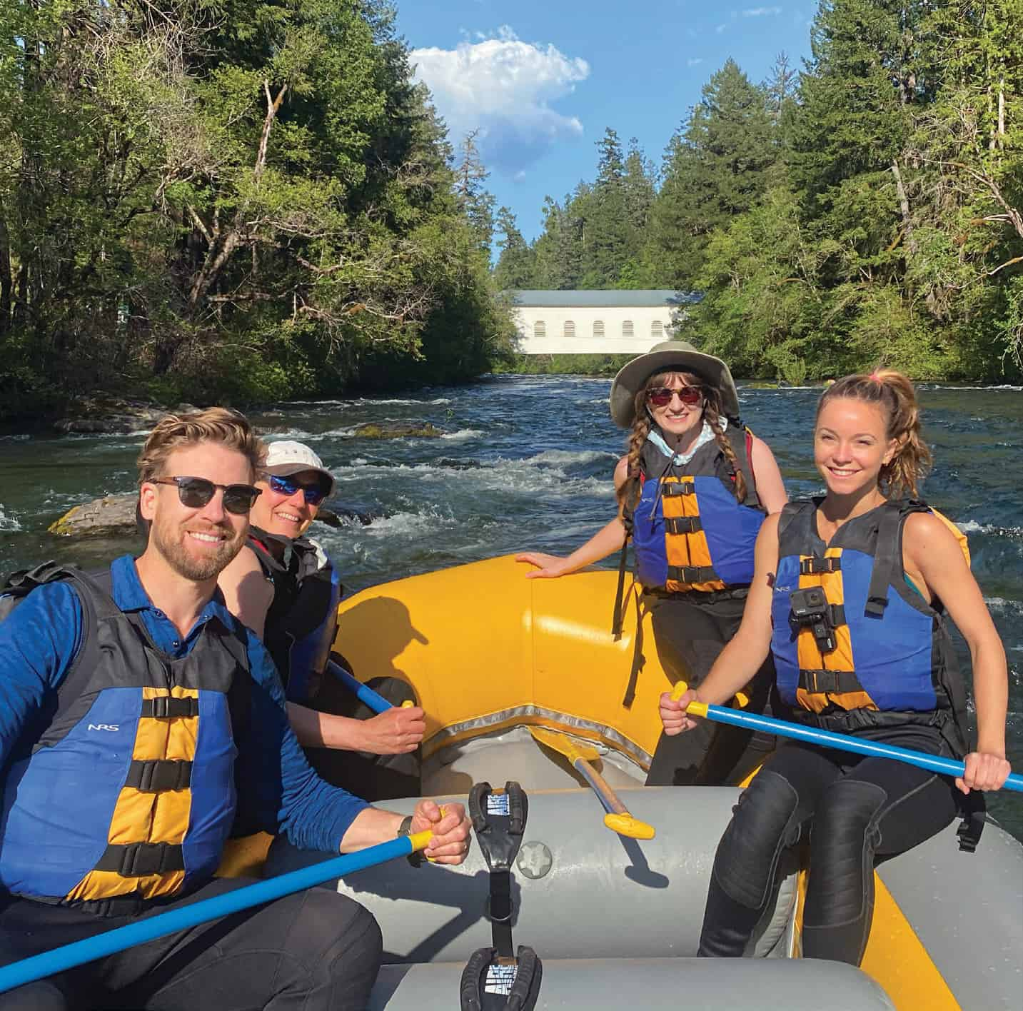 Rafting the McKenzie River is a cool reward after a day of working with volunteering vacationers.