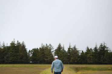 Whit Peters walks between cranberry bogs at Peters' Cranberries in Sixes.
