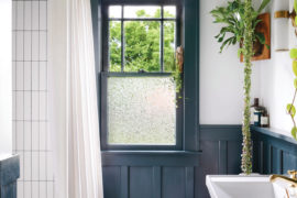 DIY wainscoting in this bathroom adds dimension, interest and a shallow shelf, too.